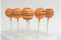 Orange with black swirl