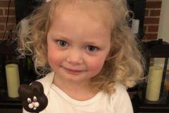Girl eating bunny cakepop